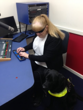 Vision Australia Radio volunteer Vicki Couzens in the Adelaide studios with her dog guide Bella